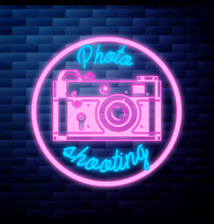 Vintage photographer emblem glowing neon sign vector