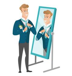 groom looking in the mirror and adjusting tie vector image vector image
