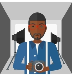 Smiling photographer holding camera vector image vector image