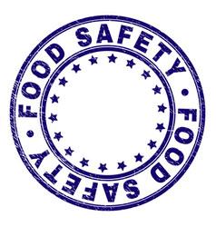Grunge textured food safety round stamp seal vector
