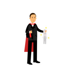 magician in an elegant black suit and red cape vector image