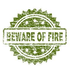 Grunge textured beware of fire stamp seal vector