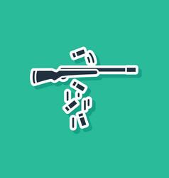 Blue gun shooting icon isolated on green vector