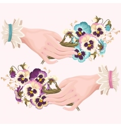 Hand with pansies vector
