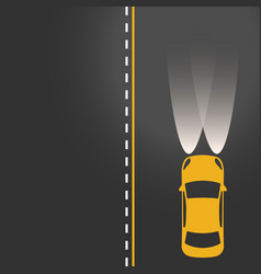 Yellow car on the road with lights on vector
