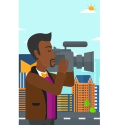 Cameraman with video camera vector