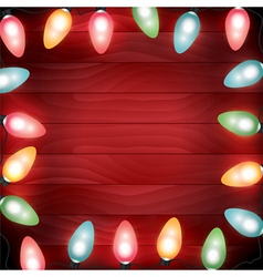 Christmas Lights Lit on a Red Wooden Background vector image vector image