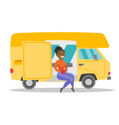 Young african woman drinking coffee in motorhome vector