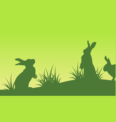 on green backgrounds easter bunny silhouettes vector image