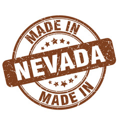 made in nevada brown grunge round stamp vector image vector image