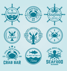 Seafood labels badges emblems and logos vector