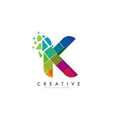 letter k design with rainbow shattered blocks vector image