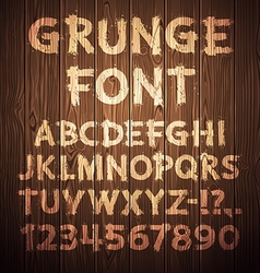 Grunge Letters and Numbers on Wooden Background vector image vector image