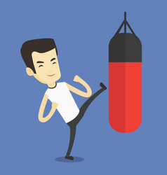 man exercising with punching bag vector image