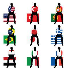 man silhouette sitting on world flag vector image