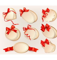 Set of beautiful retro labels with red gift bows vector image