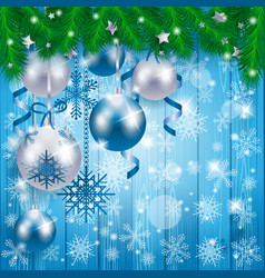 christmas baubles on wooden background in blue vector image