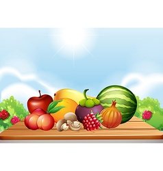Fresh fruits and vegetables on table vector
