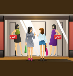 women window shopping in front of a clothing store vector image
