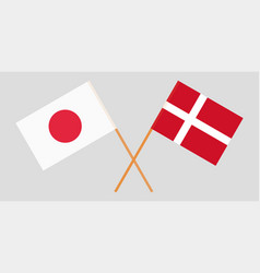Crossed danish and japanese flags vector