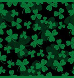 saint patricks day black background shamrock vector image