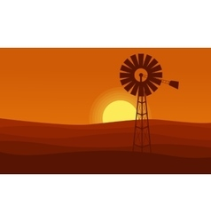Windmill on desert scenery orange background vector