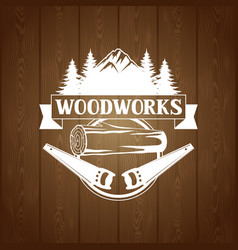 Woodworks label with wood log and saw emblem for vector