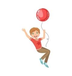 Boy flying hanging on big red balloon vector