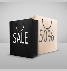 two shopping bags with written sale vector image vector image