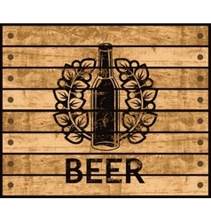 Beer bottle on wooden box vector