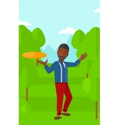 Man playing frisbee vector