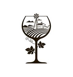 Wine glass with vineyard fields vector