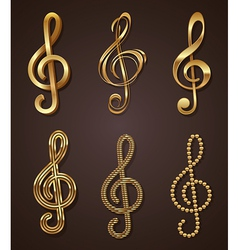 Set of golden decorative treble clef vector image