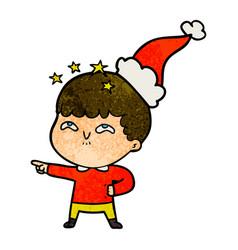 Textured cartoon of a amazed boy wearing santa hat vector