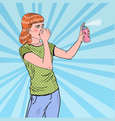 Pop art young woman spraying can of air freshener vector