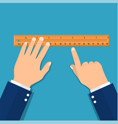 plastic measuring ruler in hand vector image