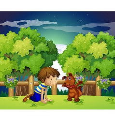 A boy and his pet playing outdoor vector image vector image