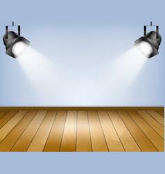 blue background with spotlights studio vector image