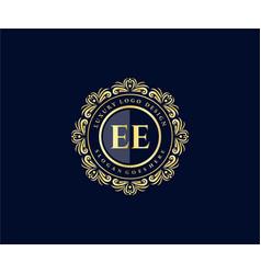 Ee initial letter gold calligraphic feminine vector