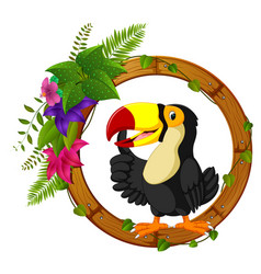 Toucan on round wood frame with flower vector