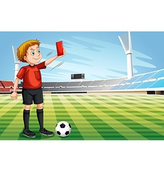 Referee showing red card in the football field vector