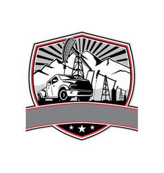 Pick-up truck and oil derrick shield badge retro vector