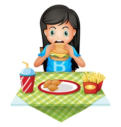 A hungry girl eating at a fastfood restaurant vector image