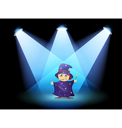 A magician standing at the stage with spotlights vector image