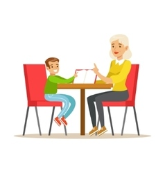 Grandmother and a boy reading a book together vector
