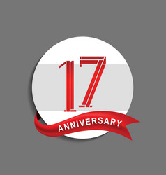 17 anniversary with white circle and red ribbon vector