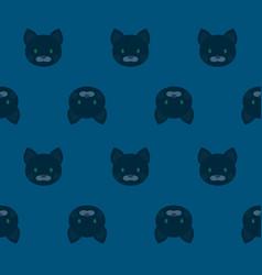 Seamless pattern - cartoon black cats on blue vector