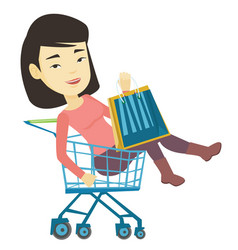 happy woman riding by shopping trolley vector image