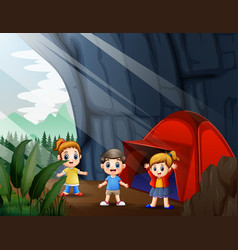 Happy children camping out in cave vector