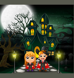 Happy couple vampire in front of the haunted house vector